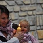bébé bougie prêtre