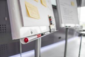 Compte-rendu sur paperboard d'un atelier en équipe.